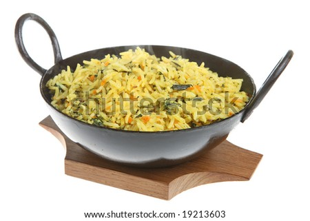 Indian pilau rice with spinach and carrots