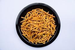 Indian popular crispy snacks namkeen thick sev, eaten during festivals and tea time munching