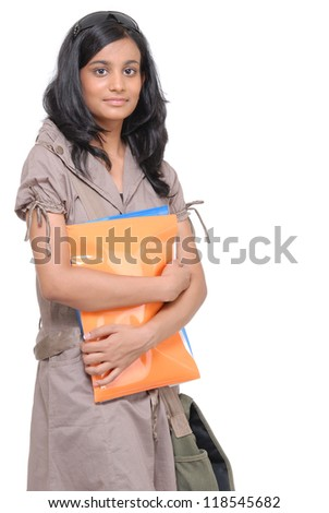 Indian pretty girl holding files and folders