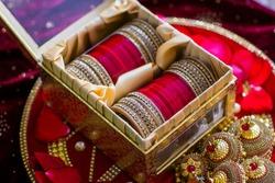 Indian Punjabi Choora pre wedding ceremony, ritual items, bangles, decorations close up