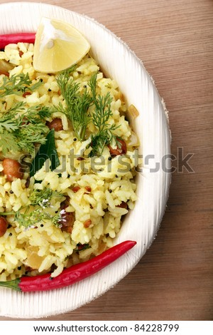 Indian rice breakfast - yellow rice garnished with coriander