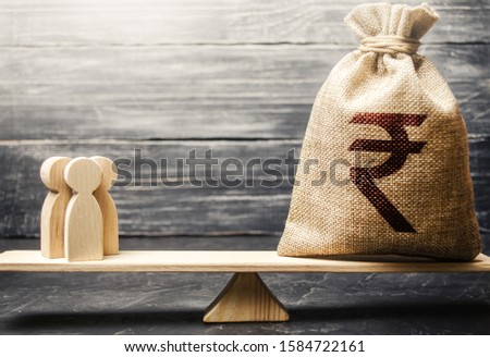 Indian rupee INR symbol on money bag and people on scales. concept attracting investment, business cooperation, crowdfunding and startup. Staff salary specialist services cost. Solvency, taxpayers