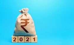 Indian rupee money bag and blocks 2021. Budget planning for next year. Revenues expenses, investment and financing. Beginning of new decade. Business plans and development prospects, trends