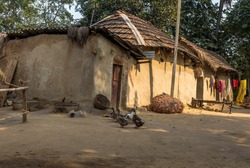 Indian rural village with mud houses and ducks in the courtyard. Photograph taken at a village in Bankura district, West Bengal, India.