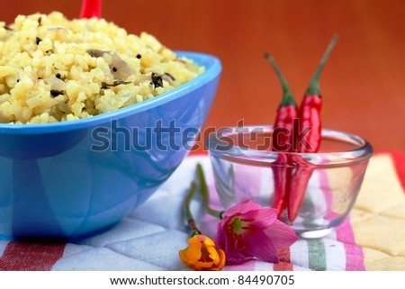 Indian saffron rice dish with chili and flowers