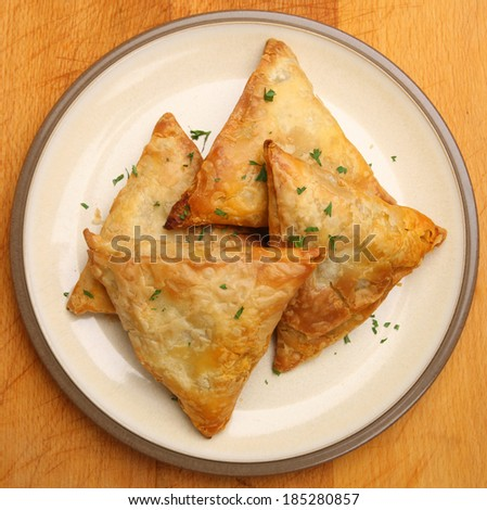 Indian samosas filled with chicken tikka curry mixture.