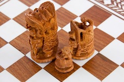 Indian sandalwood chess pieces on a board