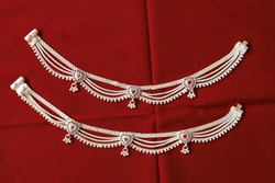 Indian Silver Anklet Isolated On Red Background.