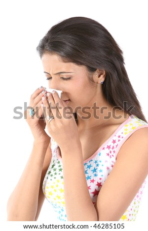 Indian slim girl sneezing with tissue paper