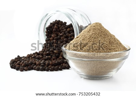 indian spices - black pepper powder,Black pepper corns scattered on white background and Black pepper Powder on Glass bowl isolated on white background. #753205432