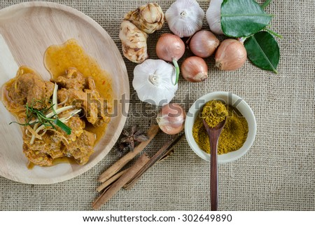 Indian Spices Curry food with herbs and curry powder on the wood dish