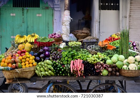 Indian street vendor with fresh vegetables and fruits along the road, Udaipur, India
