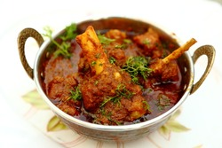 Indian style meat dish in a copper bowl