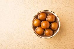 Indian sweet food Gulab Jamun served in a round ceramic bowl