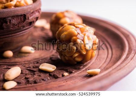 indian sweet groundnut ladoo or mungfali or peanut ladu made using roasted peanuts and jaggery