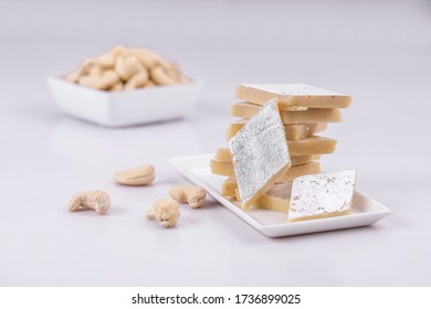 Stock photo of Indian sweets served in silver or wooden plate. variety of Peda, burfi, laddu ,kaju katli in decorative plate, selective focus