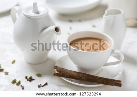 indian tea with milk in white dishware