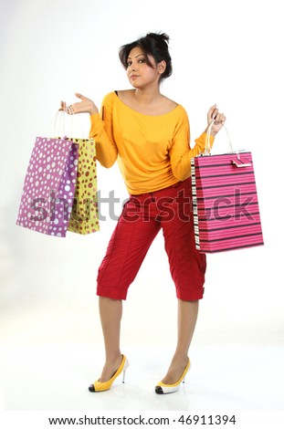 Indian teenage girl with lots of shopping bags