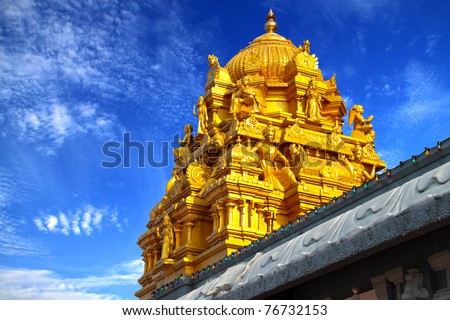 Indian Temple With Golden Roof Decorated With Various Religious Statues