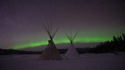Indian Tipi under the northern lights in Whitehorse, Yukon (Canada)