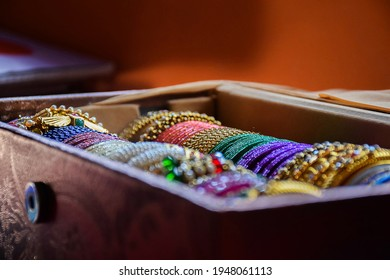 Stock photo of Indian traditional colorful bangles and bracelet kept and decorated in bangle box on blur background, focus on object at Bangalore Karnataka India. - Shutterstock ID 1948061113