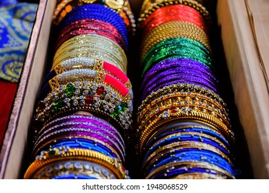 Stock photo of Indian traditional colorful bangles and bracelet kept and decorated in bangle box on red background, focus on object at Bangalore Karnataka India. - Shutterstock ID 1948068529