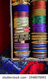 Stock photo of Indian traditional colorful bangles and bracelet kept and decorated in bangle box on red background, focus on object at Bangalore Karnataka India. - Shutterstock ID 1948070092