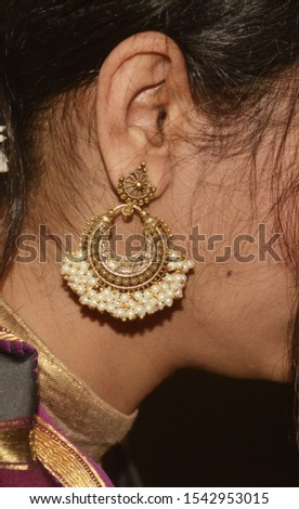 Indian Traditional Earings On Ear.Side view.  #1542953015