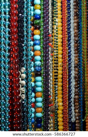 Indian traditional handicraft (glassbeads) on the street market, Arambol, Goa, India #586366727