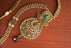 Indian traditional jewellery over wooden background, Selective focus
