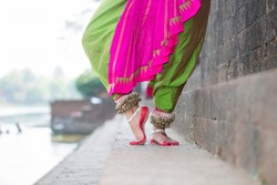 Indian Traditional odissi dance feet with ankle bells called ghungroo, Alta(Red Dye) at Bindu Sagar, Bhubaneswar, Odisha, India.