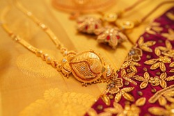 indian traditional saree and gold jewellery  for royal wedding celebration