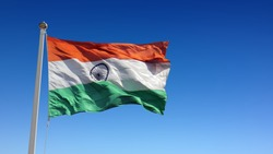 Indian Tricolor flag waving in wind against sky