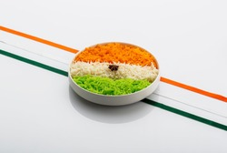 Indian Tricolour or Tiranga Rice for indian Republic and Independence day celebration served in a ceramic plate