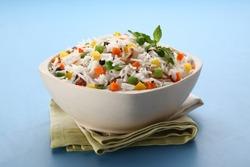 indian veg biryani, veg pulav, Indian vegetable pulav, Biriyani, vegetable Biriyani served in a ceramic bowl on blue background