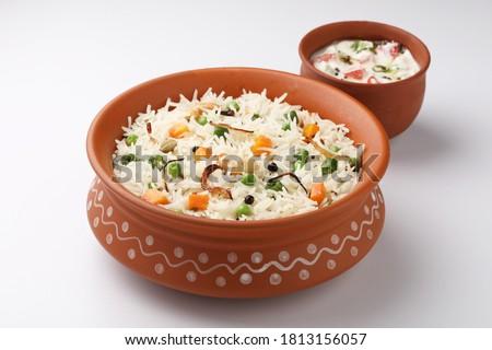 indian veg biryani, veg pulav, Indian vegetable pulav, Biriyani, vegetable Biriyani served in a terracotta bowl  Stock fotó ©