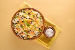 Indian Veg Pulav - Basmati rice  is browned in oil and then mixed with vegetables nuts, fruits etc. selective focus