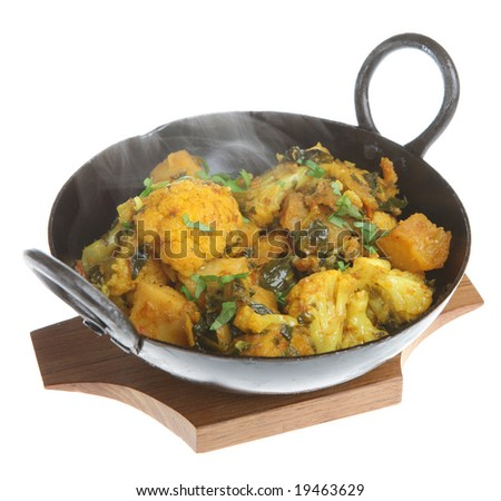 Indian vegetable curry with cauliflower, spinach and potatoes - stock photo