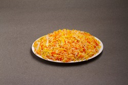 Indian vegetable pod pulav or biryani made from basmati rice, served in a white bowl . selective focus