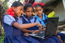 indian village government school girls operating laptop computer system at rural area in india