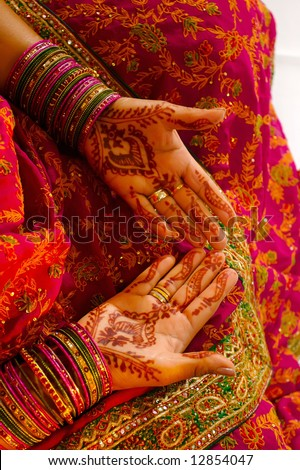 stock photo Indian wedding bride getting henna applied