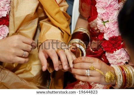 Indian wedding couple exchanging rings
