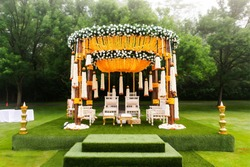 Indian wedding mandap decor yellow and white flowers