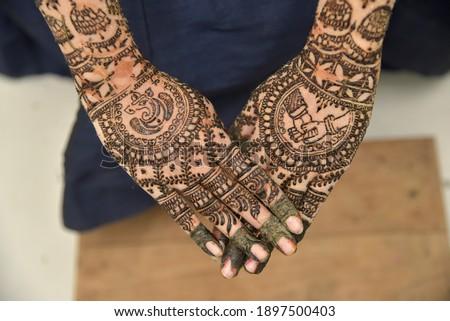 Indian wedding mendi function. hand mendi art close up image background blur. Stock photo ©