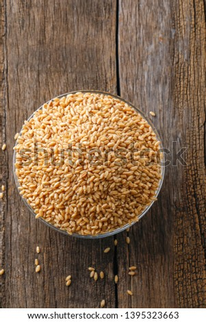 indian wheat grain ,  Wheat grain in bowl #1395323663