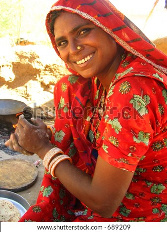 http://image.shutterstock.com/display_pic_with_logo/4247/4247,1130988639,1/stock-photo-indian-woman-cooking-chapati-689209.jpg Indian Woman Cooking