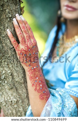 indian woman hand with henna. Details from a hindu wedding