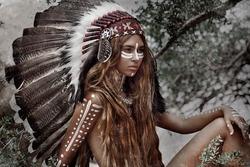 Indian woman hunter in headdress
