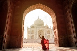 Indian woman in red saree/sari in the Taj Mahal, Agra, Uttar Pradesh, India