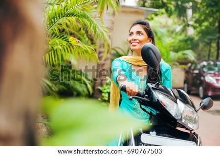 indian woman riding motorbike